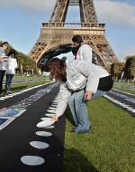 Volunteers of the French NGO Action Contre la faim, Action against hunger, lay down plates on the Champ de Mars, next to the Eiffel Tower, during World Food Day, in Paris, Saturday Oct. 16, 2010. The 10,000 plates displayed symbolized the 10,000 children who died every day of malnutrition.(AP Photo/Thibault Camus)