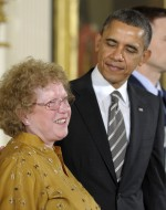 President Obama congratulates Suzanne Swann, daughter of PFLAG founder Jeanne Manford, at the White House before presenting her mother posthumously with the 2012 Presidential Citizens Medal, the nation's second-highest civilian honor. © AP Images/Susan Walsh