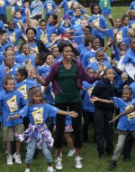 First lady Michelle Obama and local children attempt to break the Guinness World Record for the most people doing jumping jacks in 24 hours at the White House on October 11, 2011. ©AP Images