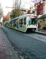 Portland, Oregon, pioneered smart urban growth policies in the United States. The city's extensive transit network includes a streetcar. ©AP Images
