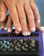 The refreshable Braille keyboard enables people with visual disabilities to read information displayed on a computer. The eight-dot Braille cells change – or refresh – as the words change on the screen. AP Images / Elaine Thompson